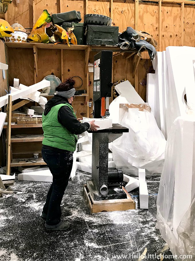 An artist carving foam float props at Blaine Kern's Mardi Gras World in New Orleans.