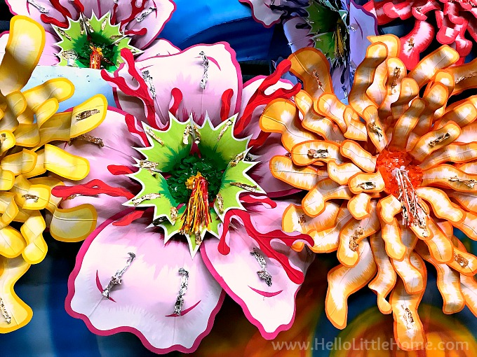Huge, colorful flowers decorating a Mardi Gras float.