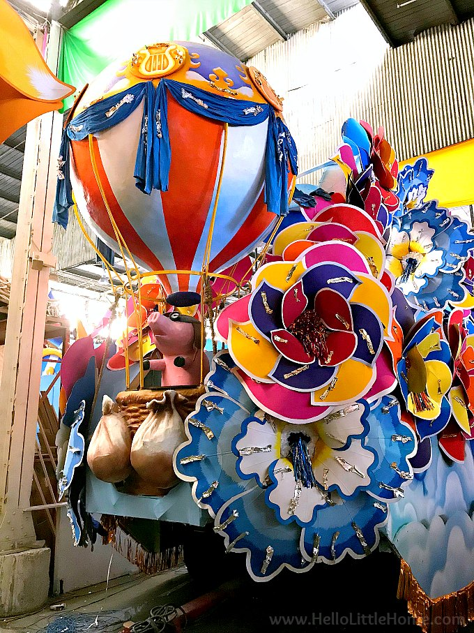 Mardi Gras float decorated with a pig in a hot air balloon.