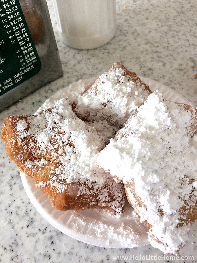 Eating beignets at Cafe Du Monde on a rainy day.
