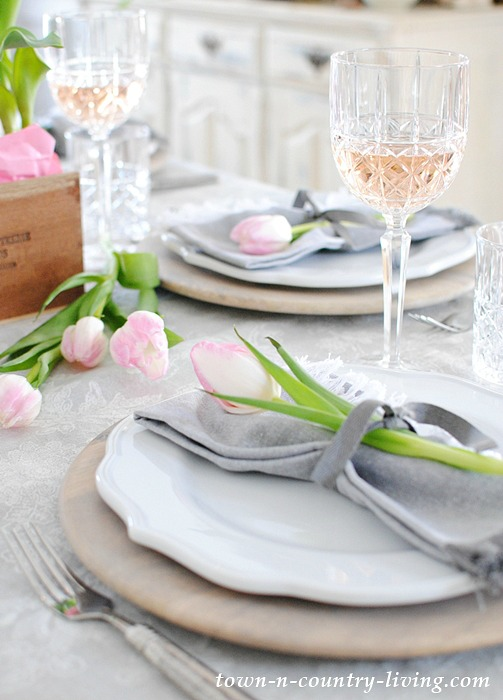 A pretty gray and pink Valentine's Day table setting.