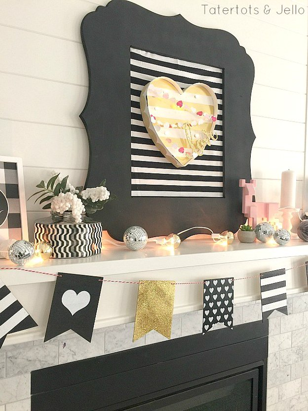 A black, gold, and white mantle is a fun Valentine's Day decor idea.
