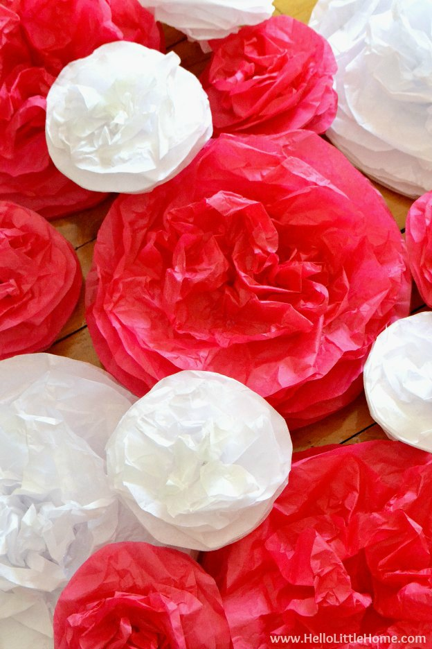 White and Pink DIY Tissue Paper Pom Poms are a fun Valentine's Day decor idea.