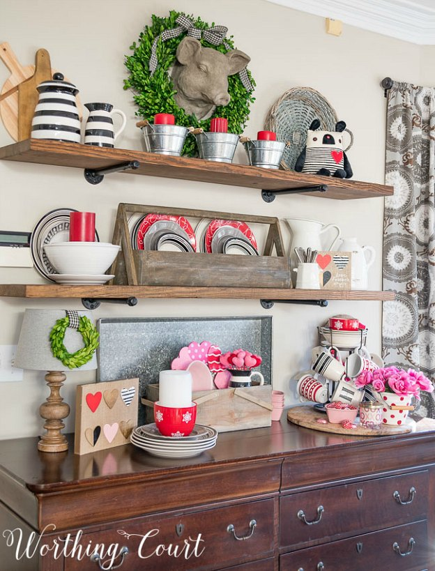 Easy Valentine's Day decorating idea: adding pops of red and pink to a buffet.