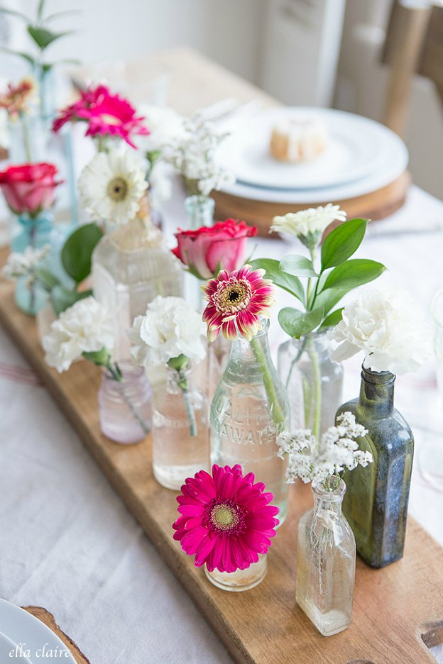 Flowers in antique glass vases make a pretty Valentine's Day tablescape.