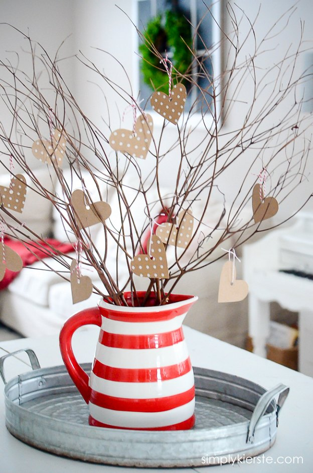 Tree branches decorated with hearts, a cute Valentine's Day decor idea.