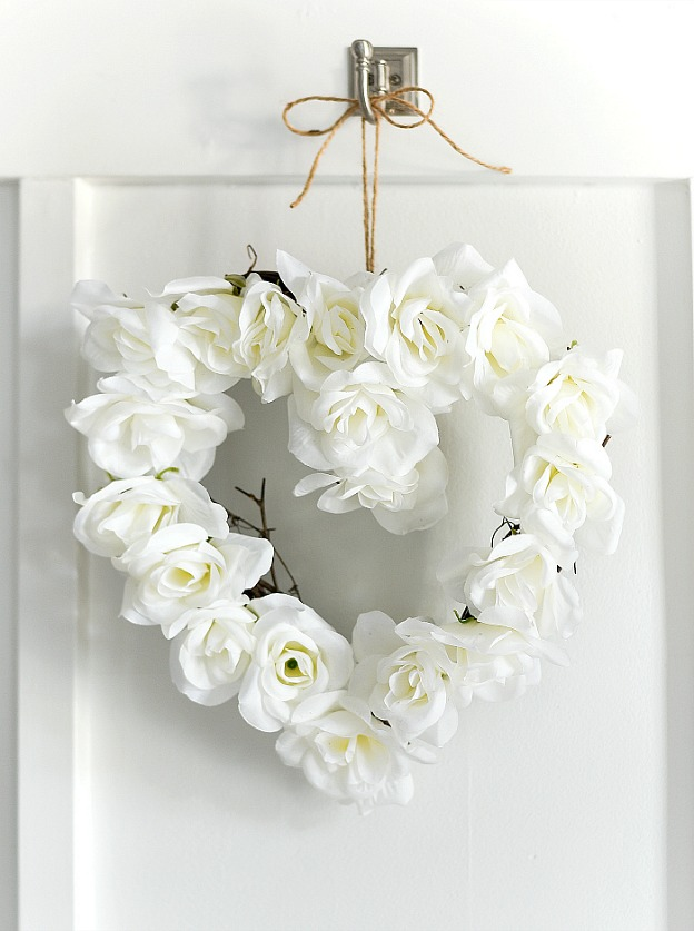 A Valentine's Day wreath decorated with roses.