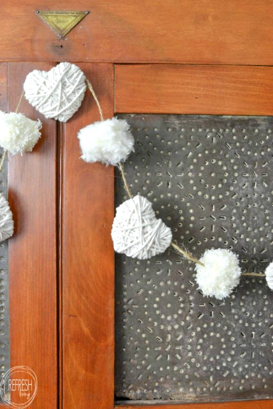 An easy yarn heart garland is a simple Valentine's Day decor idea.