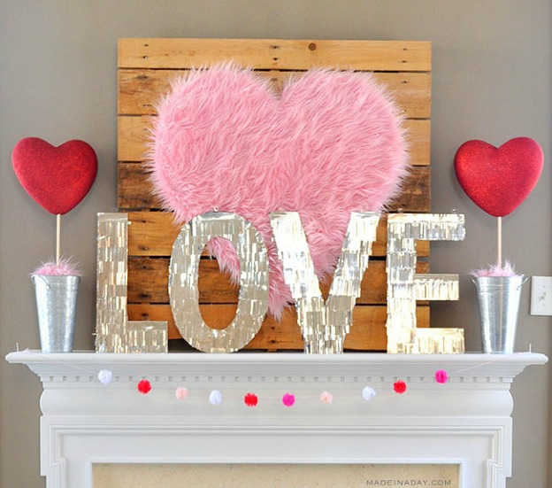 Valentine's Day decorations on a fireplace mantle.