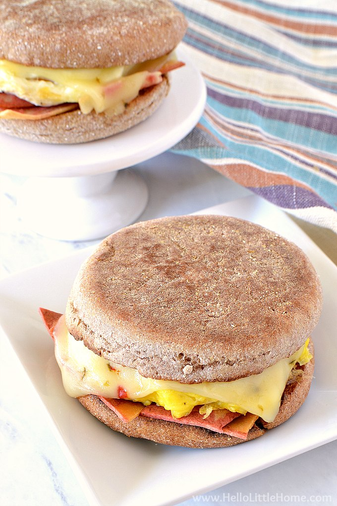 Two egg sandwiches on plates with a striped napkin.