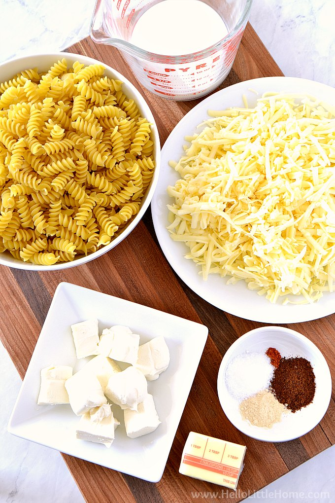 Instant Pot Mac and Cheese ingredients: pasta, milk, cream cheese, cheddar, monterey jack, spices, and butter.