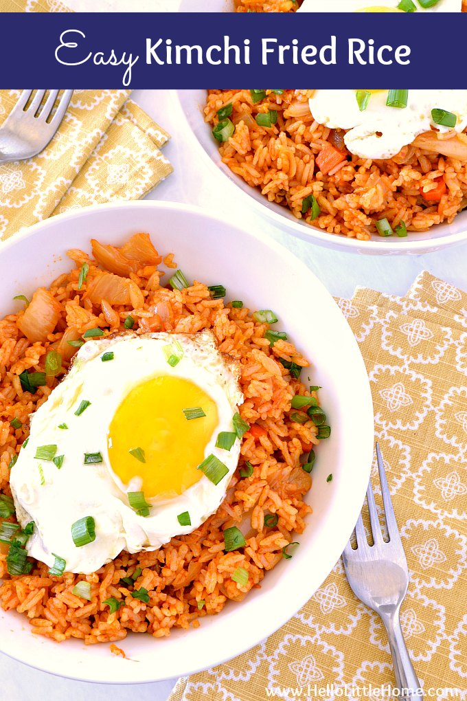 Easy Kimchi Fried Rice recipe! Learn how to make a simple Korean fried rice that's vegetarian and vegan friendly! This healthy Kimchi Fried Rice is topped with an egg and is a delicious meal for spicy food lovers. A simple kimchi fried rice recipe that's gluten free and made with simple ingredients: leftover rice, kimchi, gochujang sauce, soy sauce, sesame oil, vegetables, and green onions. | Hello Little Home #friedrice #kimchifriedrice #koreanfood #vegetarianrecipe #kimchi #spicy