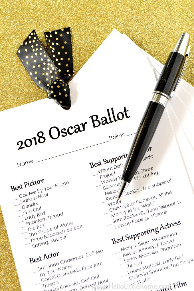 Free Printable Oscar Ballot fanned out and topped wiht a black pen.
