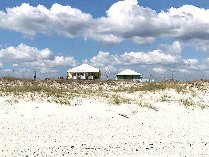 Two houses overlooking sandy Orange Beach.