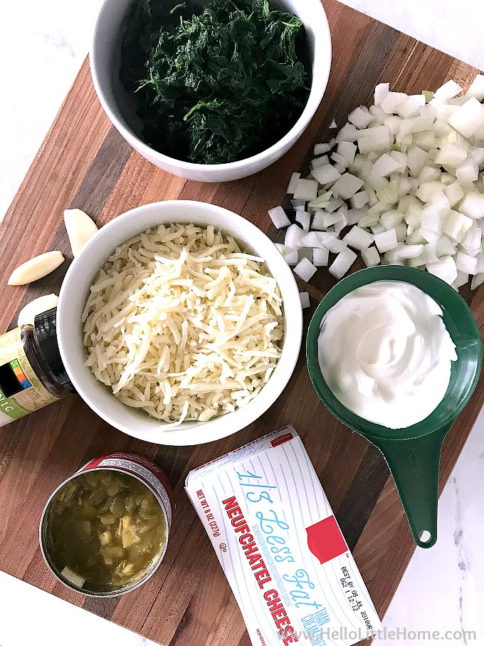 Mexican Baked Spinach Dip ingredients: spinach, onions, garlic, green chiles, cream cheese, sour cream, and pepper jack cheese (no mayo).