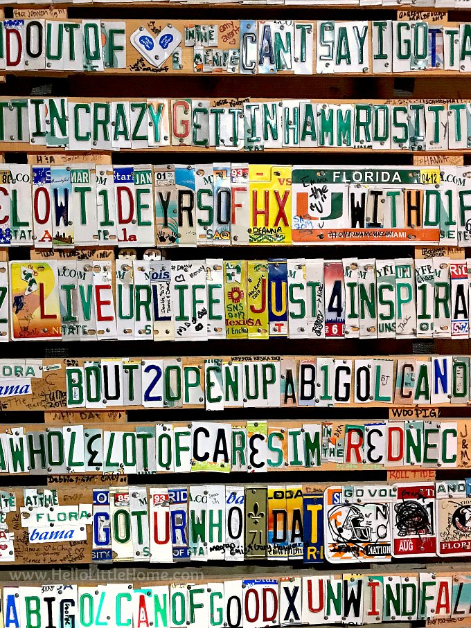 A wall with a sign made from license plates at Flora-Bama, an Orange Beach bar and restaurant.