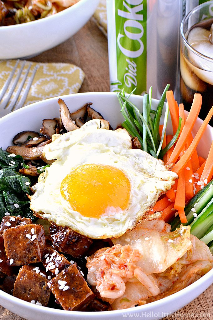 Closeup of a Tofu Bibimbap recipe in a bowl with a Diet Coke in the background.