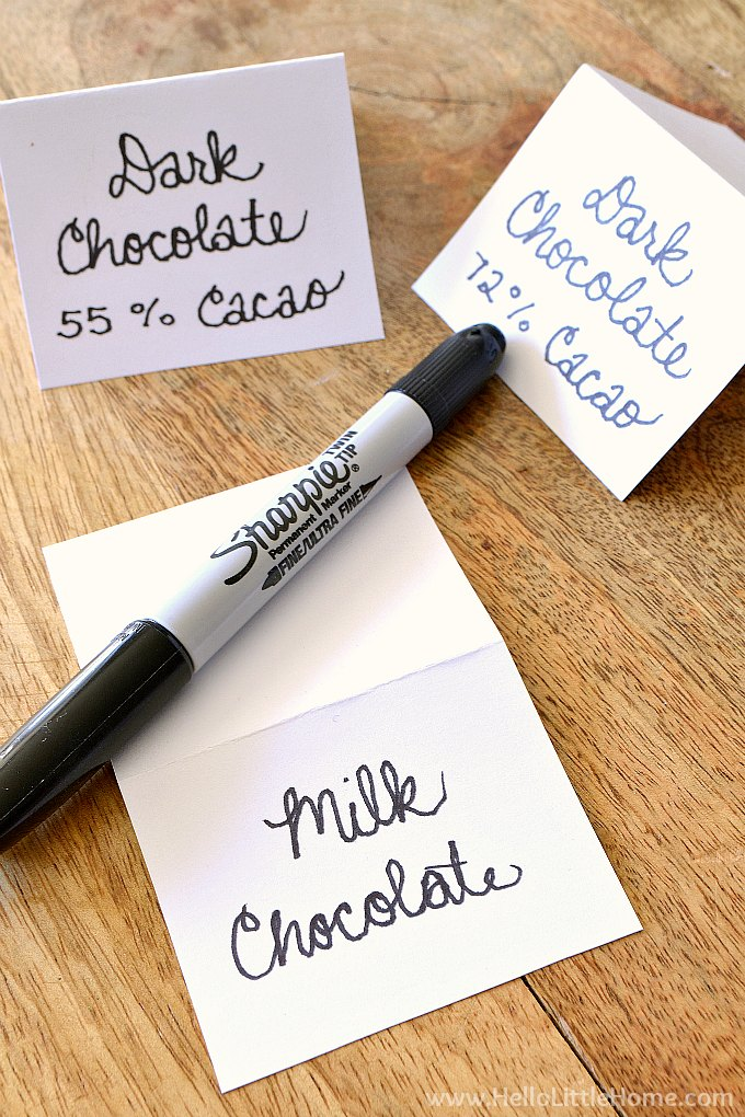 Creating labels for different types of chocolate for the wine and chocolate tasting with a sharpie and cardstock.
