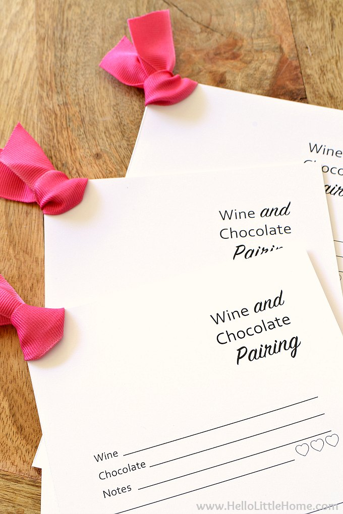 Three wine and chocolate tasting cards.