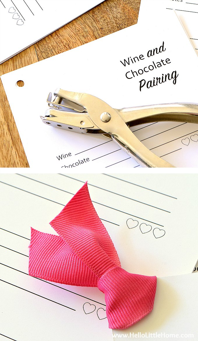 Using a hole punch and ribbon to assemble the free printable wine and chocolate tasting cards.
