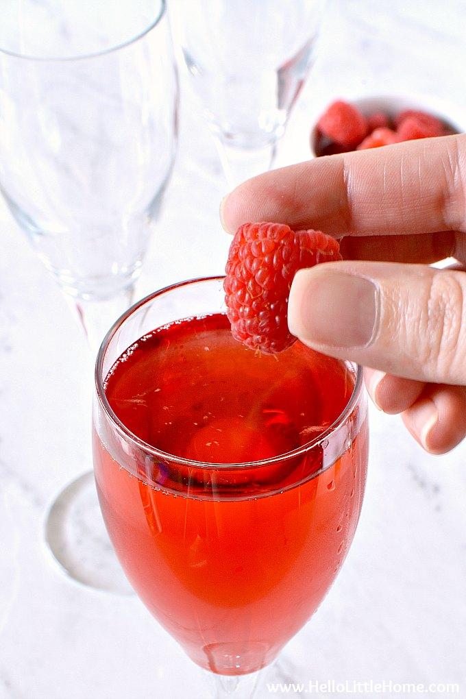 Adding Fresh Raspberries to a Raspberry Mimosa.