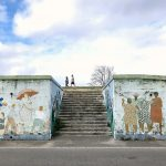 Murals painted on stairs leading up to the Algiers Levee Path.