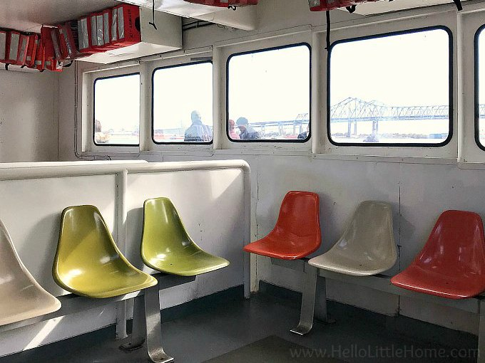Seats and a window on the inside of the Algiers Point Ferry.