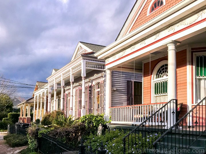A row of colorful houses with front porches.