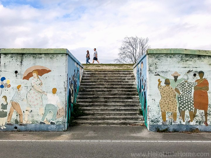 The levee decorated with murals surrounding the stairs.