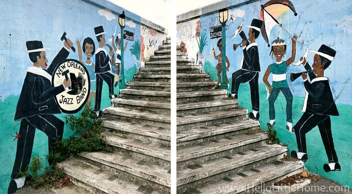 A mural depicting a brass band on stairs leading up to the levee.