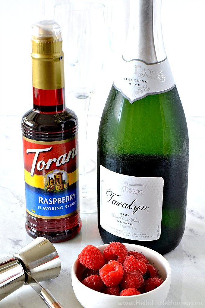 Raspberry Bellini Ingredients: Raspberry Syrup, Champagne, and Fresh Raspberries
