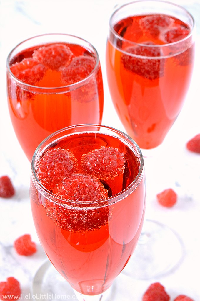 An easy Raspberry Bellini recipe topped with fresh raspberries.