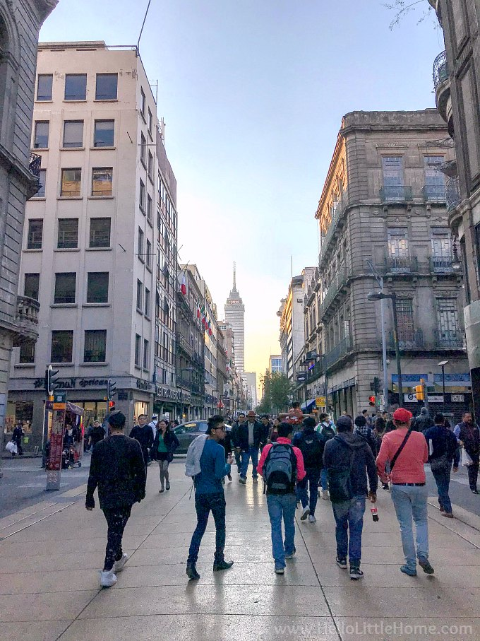 Walking on Calle Francisco I. Madero in the historic center of Mexico City.
