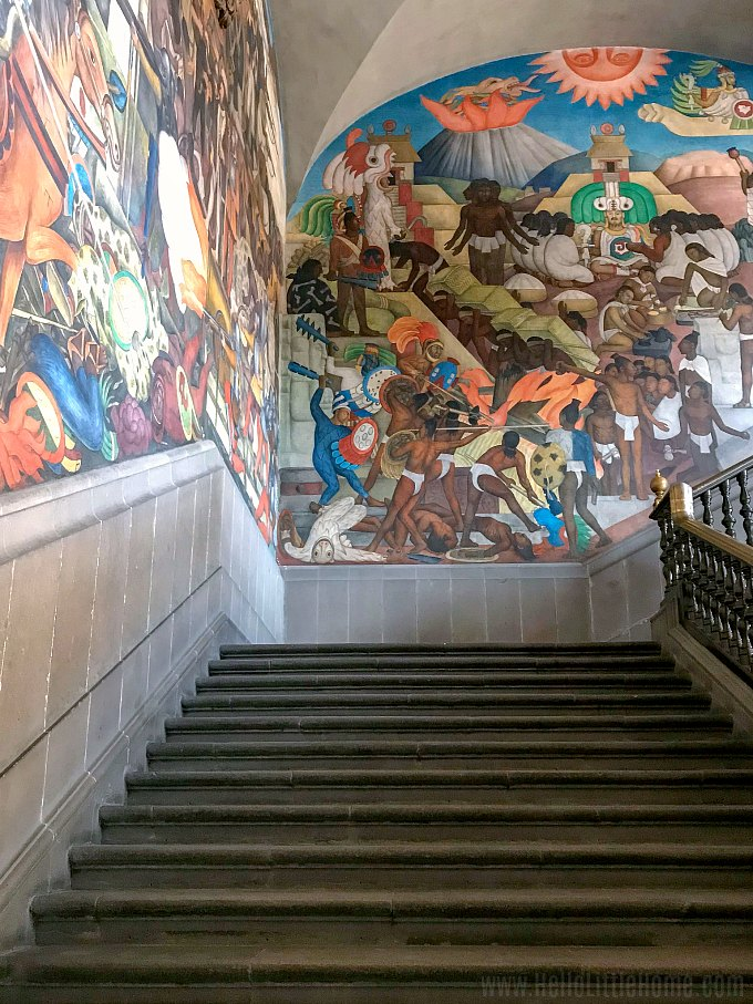 A staircase with Diego Rivera murals in Mexico City's National Palace.