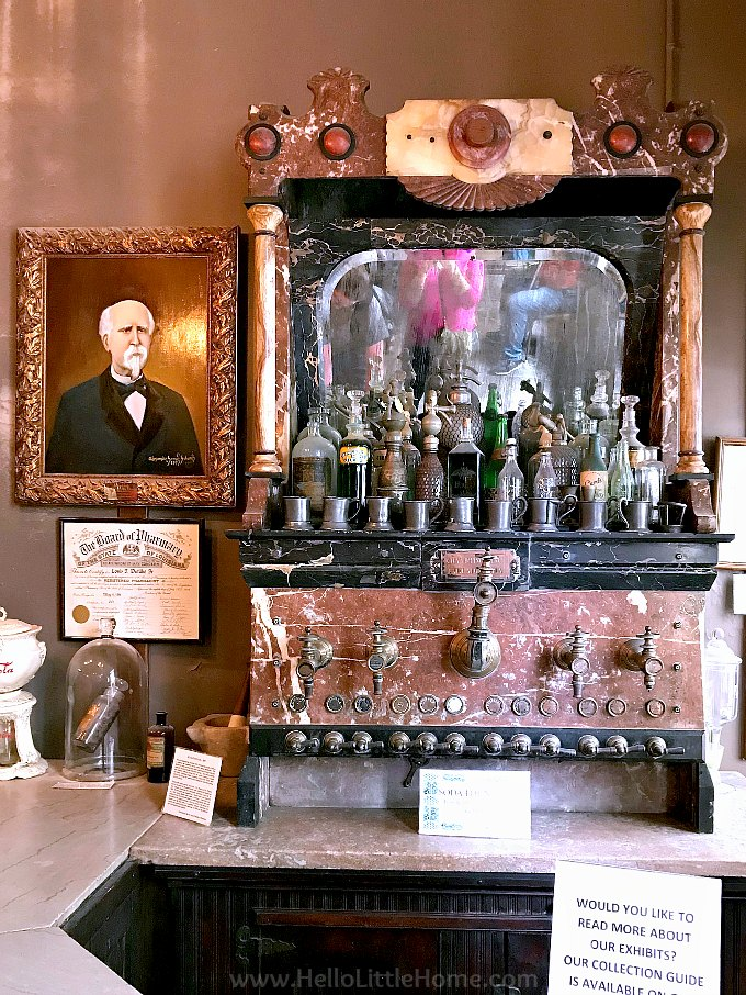 Soda fountain and portrait of Louis J. Dufilho, Jr., the first licensed pharmacist, at the New Olreans Pharmacy Museum.