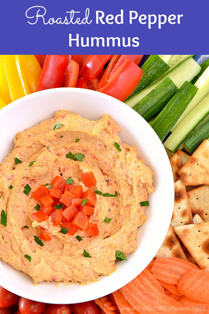 Learn how to make Roasted Red Pepper Hummus. Easy recipe + video! This homemade Roasted Red Pepper Hummus recipe is fast and affordable to make. Make this spicy red pepper hummus in minutes. It's vegan, vegetarian, gluten-free, oil free, and so much better than store bought. Serve this healthy hummus recipe with veggies, pita, bread, or crackers for a lunch, party appetizer, or snack. | Hello Little Home #hummus #appetizer #roastedredpeppers #roastedredpepperhummus #chickpeas #vegan #vegetarian