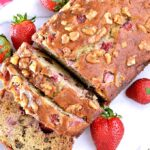 Sliced Strawberry Banana Nut Bread on a platter.