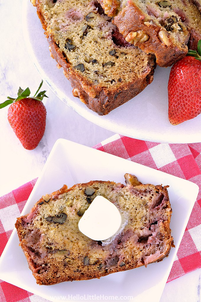 A slice of Strawberry Banana Bread on a plate with butter.