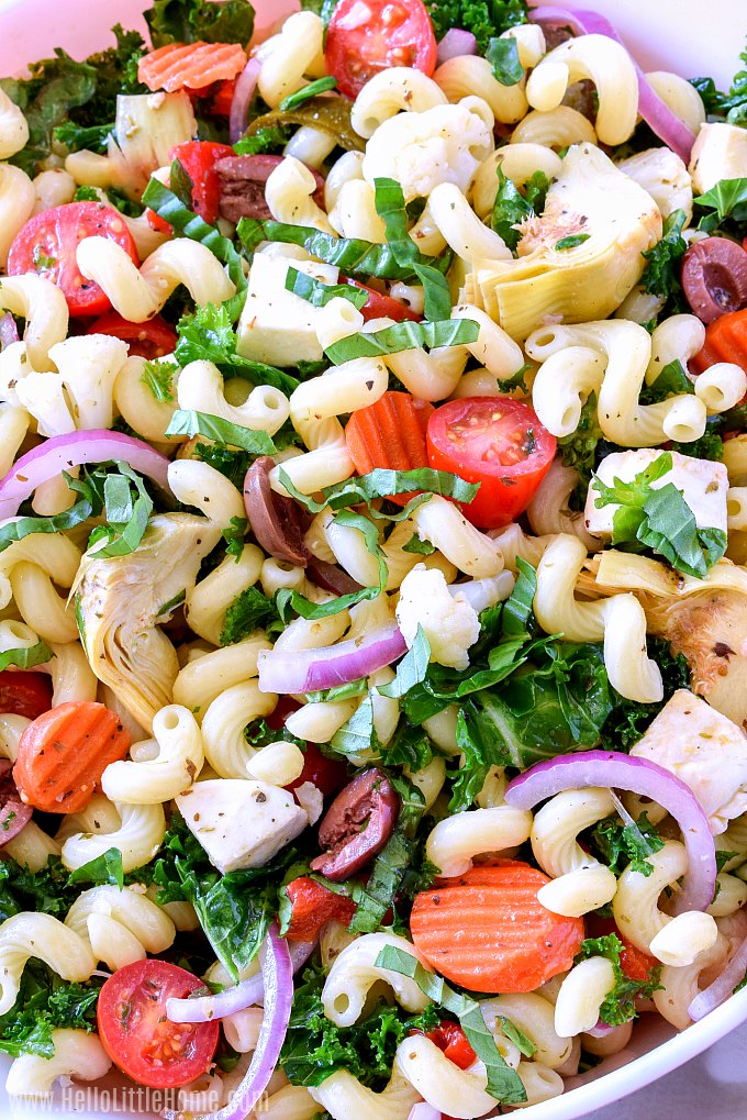 An easy Italian Antipasto Pasta Salad recipe with fresh and pickled veggies, olives, fresh mozzarella, and kale.
