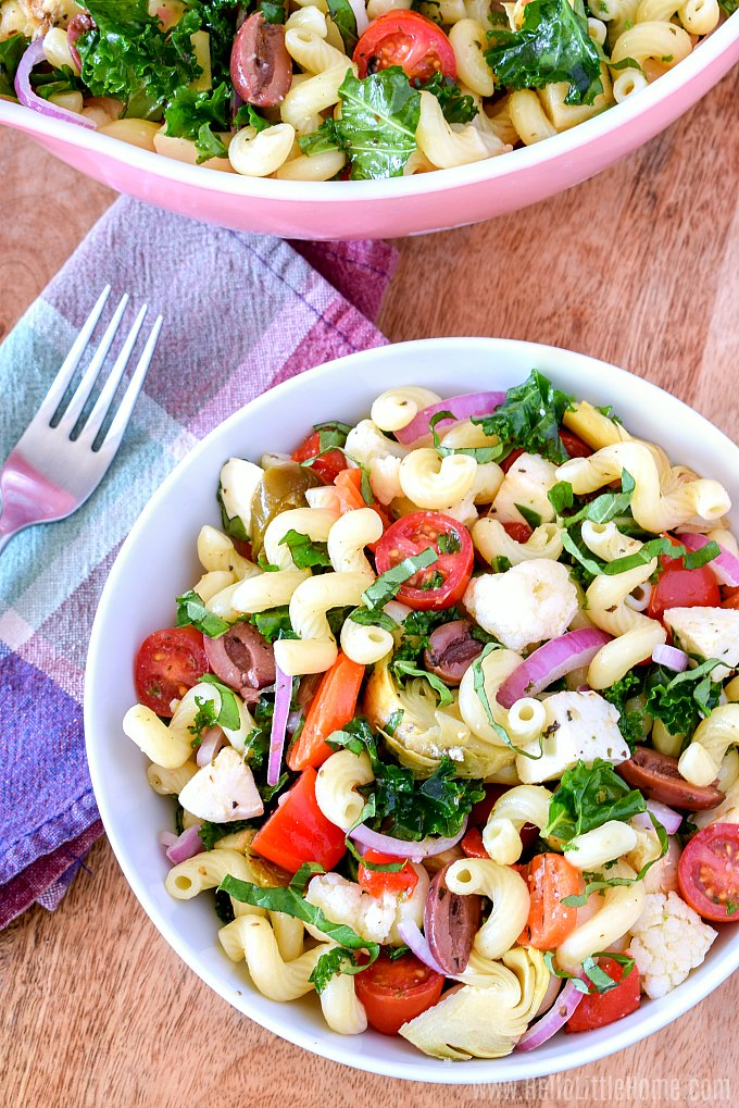 A big bowl of Italian Pasta Salad with homemade Italian dressing, fresh and pickled veggies, olives, and fresh mozzarella.
