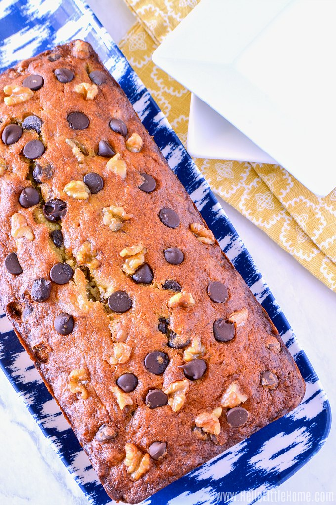 A freshly baked Banana Chocolate Chip Loaf topped with nuts and chocolate chips.