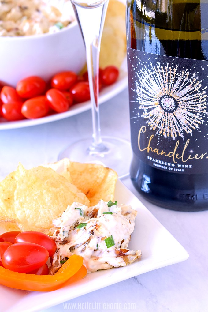 Caramelized Onion Dip paired with chips, veggies, and sparkling wine.