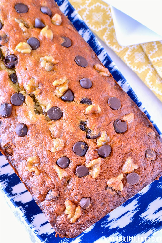 A loaf of Chocolate Chip Banana Nut Bread served on a tray.