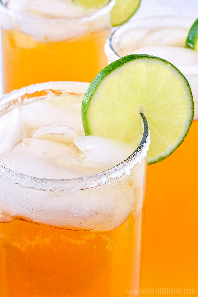 Easy Chelada beer drink garnished with a salted rim and slice of lime.