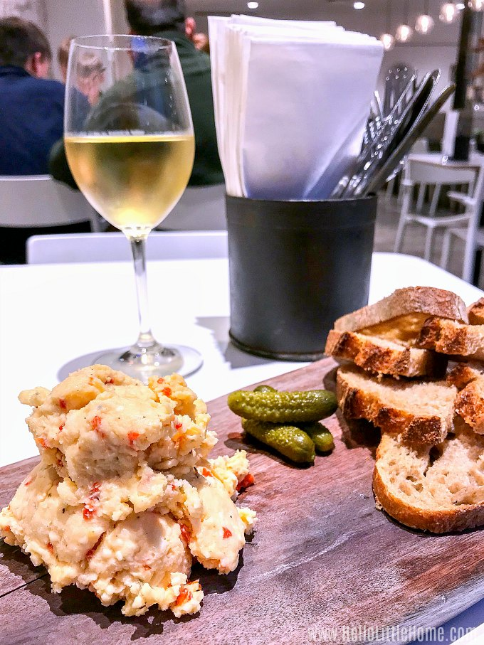 Cool off with a glass of wine and pimiento cheese at St. James Cheese Company during a hot day in New Orleans.