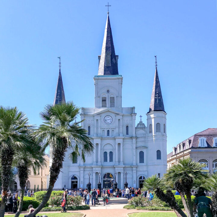 The exterior of St. Louis Cathedral on a summer day in New Orleans.