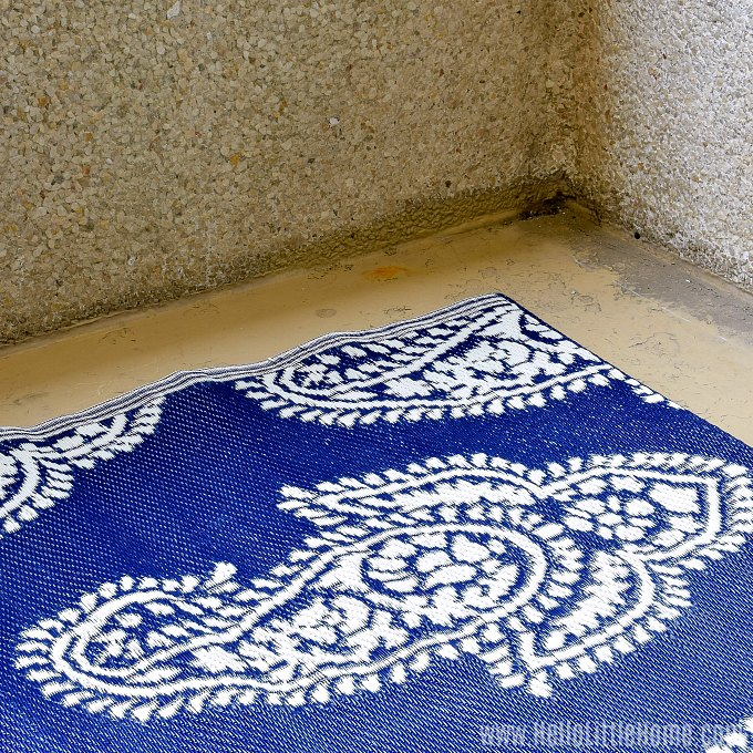A colorful area rug for a small patio.