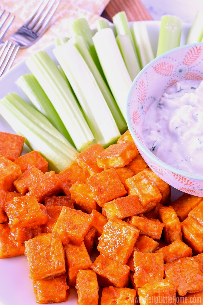 Spicy Buffalo Tofu served with celery sticks and blue cheese dip.