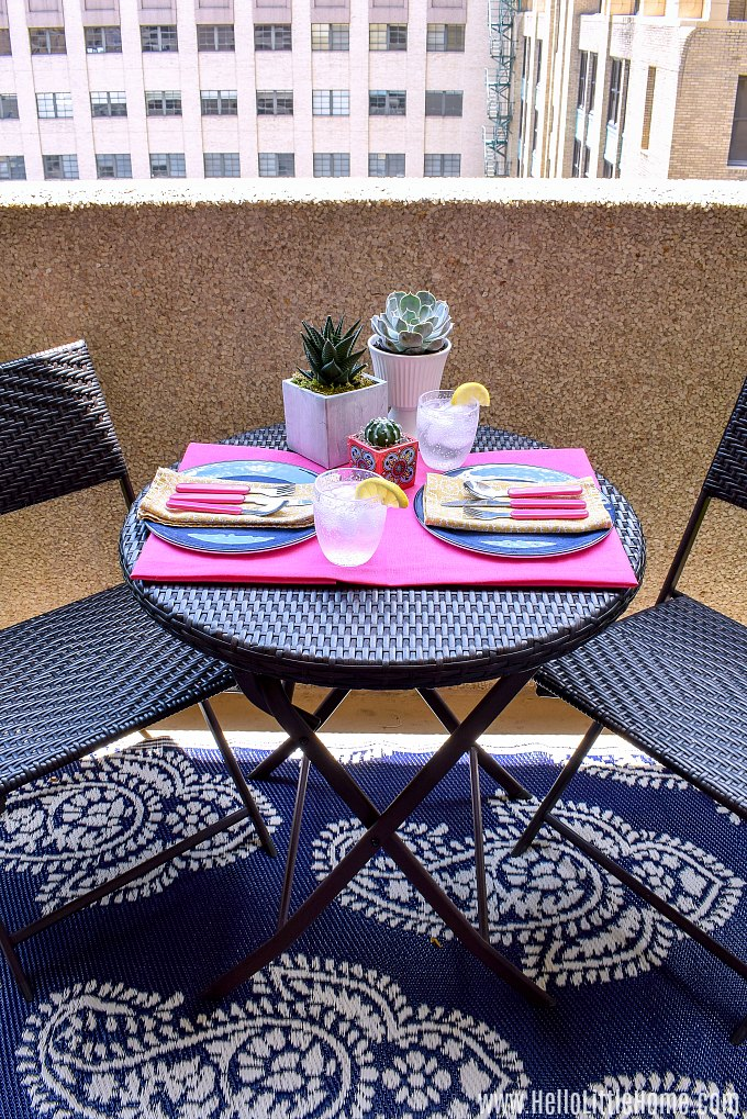 A outdoor table setting, perfect for decorating a small patio on a budget.