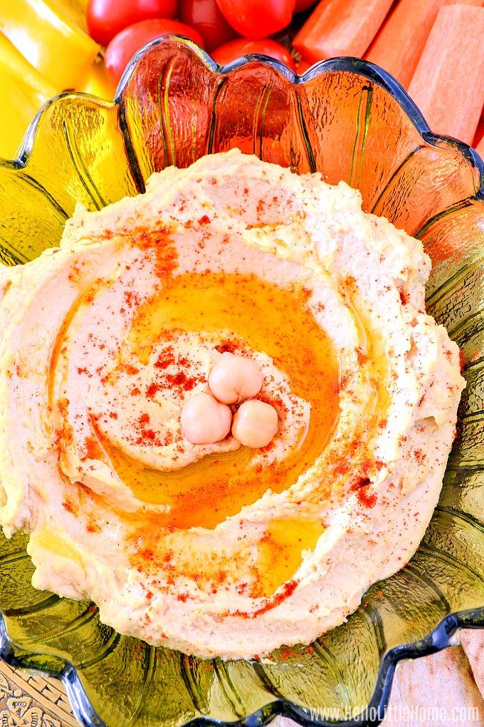 Homemade hummus recipe served with fresh veggies.